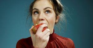 A-young-woman-eating-an-apple